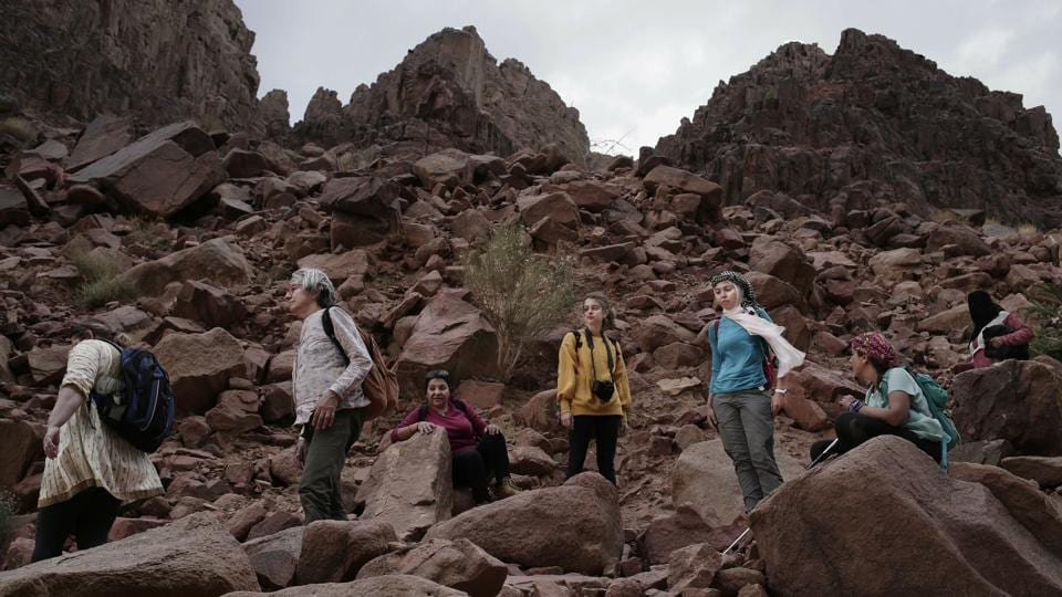 Tourists trek in the mountains near Wadi Sahw in South Sinai. Violence has stayed far from southern Sinai, where tourist resorts are located — but the industry has had to push hard to win tourists back. On a recent tour joined by the Associated Press, 16 female tourists — from Korea, New Zealand, Europe, Lebanon and Egypt were led through the rugged landscape in and around Wadi Sahu. (Nariman El-Mofty / AP)