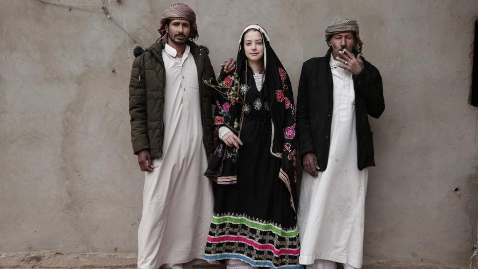 "An Egyptian student borrows a Bedouin wedding dress for a photograph with Hamada Bedouin men. ""I think south Sinai is safe especially when you are in the care of Bedouins. ... This is where I feel at home. Every corner there is scenery and another beautiful view,"" said Marion Salwegter, a 68-year-old Dutch woman who travels to southern Sinai every year alone to escape the winters in Holland. (Nariman El-Mofty / AP)"