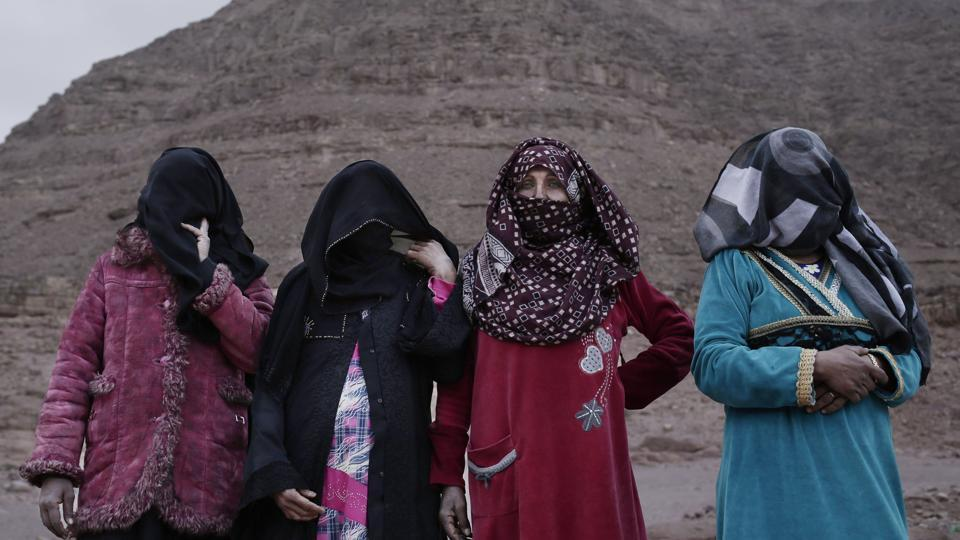 "(L-R) The first female Bedouin guides, Selima, Umm Yasser, Umm Soliman, and Aicha. Umm Yasser is breaking new ground among the Bedouin as one of four women from the community who for the first time are working as tour guides. ""It is against our culture, but women need jobs,"" the 47-year-old said. ""People will make fun of us, but I don't care. I'm a strong woman."" (Nariman El-Mofty / AP)"