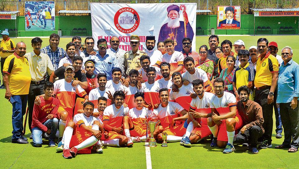 Prabhakar Aspat Academy with their trophy after winning the first Mar Osthathios hockey tournament at Major Dhyan Chand Hockey Stadium on Saturday.