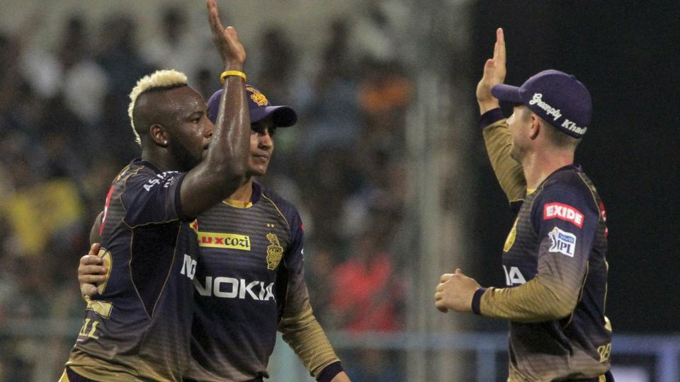 Kolkata Knight Riders Andre Russell celebrates with his teammates after the fall of a wicket.