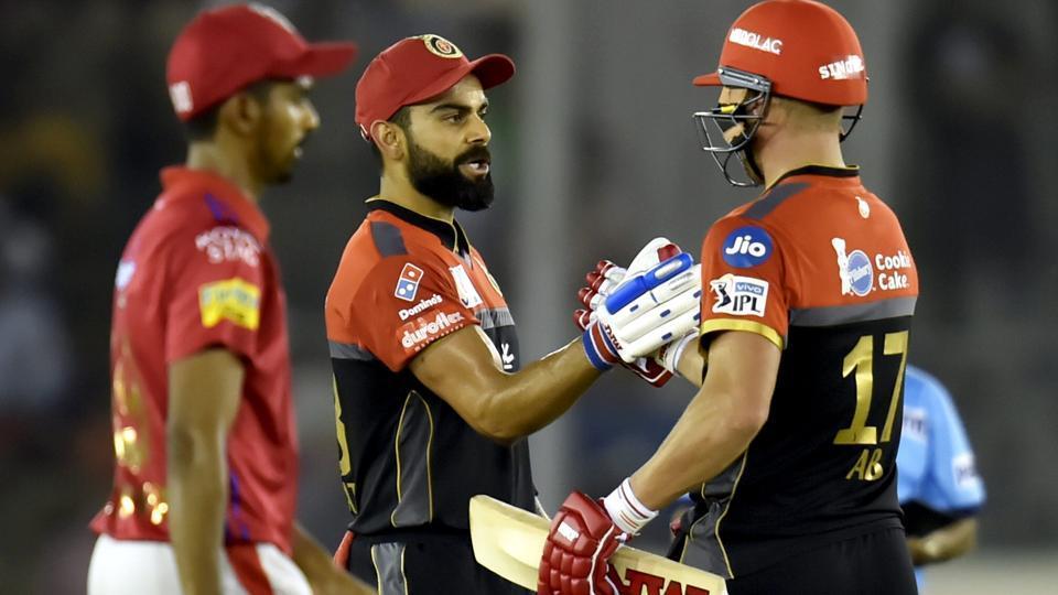 Royal Challengers Bangalore (RCB) batsman Virat Kohli celebrates his fifty with AB de Villiers. (PTI)