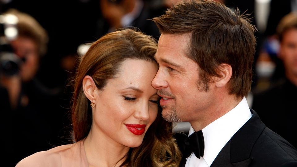 Angelina Jolie 'wants Brad Pitt back so they can start a family' despite divorce battle