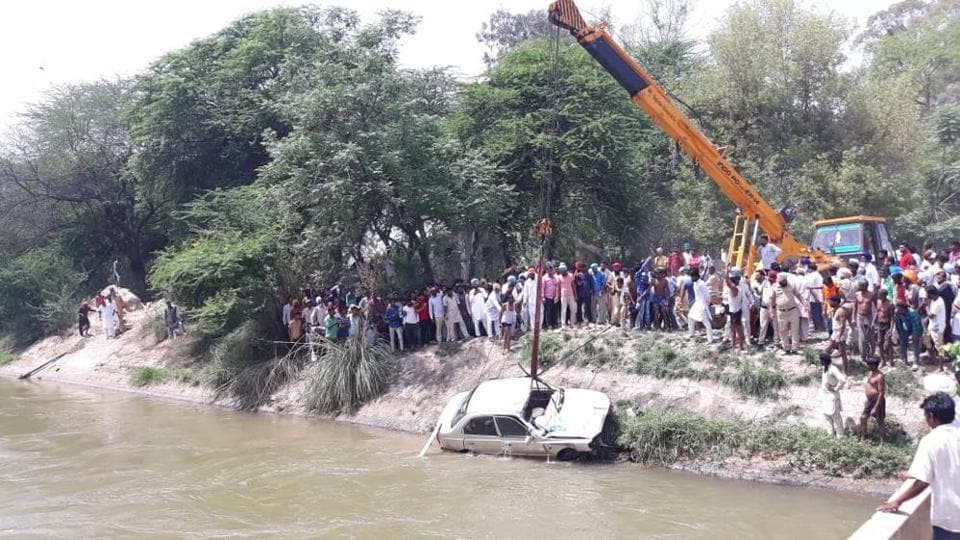 The drowned car being recovered from the canal in Fazilka on Sunday.