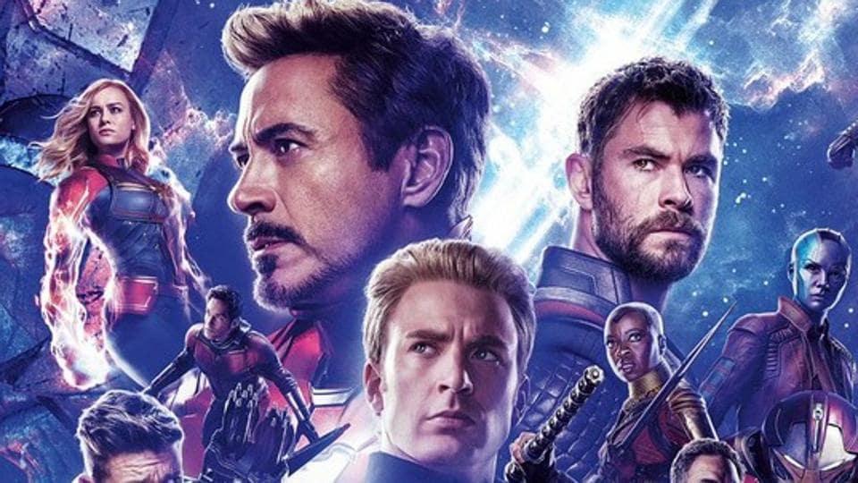 Robert Downey Jr, Chris Evans and others on an Avengers: Endgame banner.