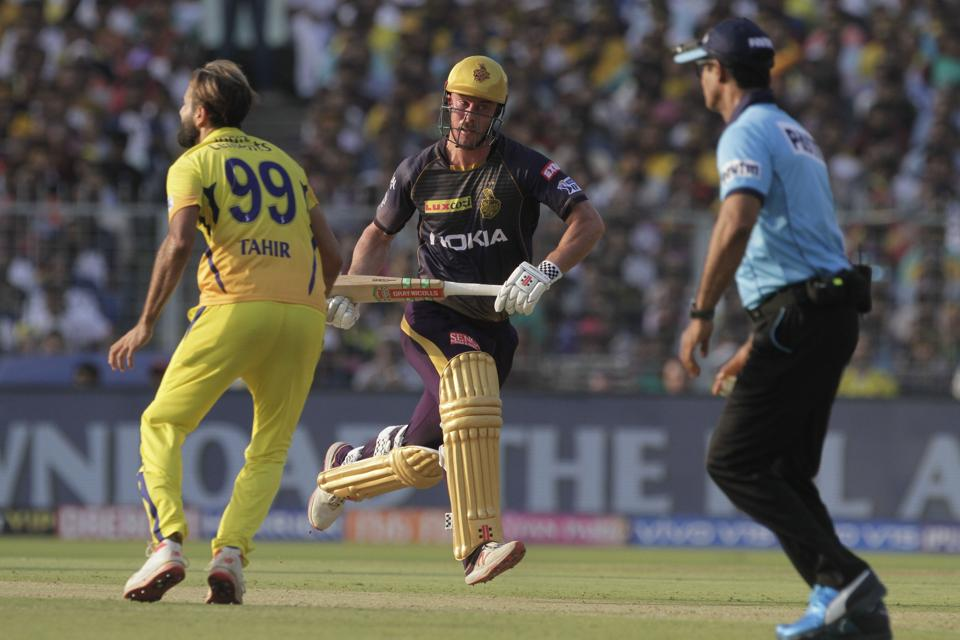 Kolkata Knight Riders' Chris Lynn scores a run as Chennai Super Kings' Imran Tahir, left, reacts during the IPL cricket T20 match against in Kolkata. (AP)