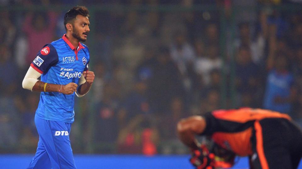 Delhi Capitals bowler Axar Patel (L) celebrates after he dismissed Sunrisers Hyderabad cricketer Vijay Shanker.