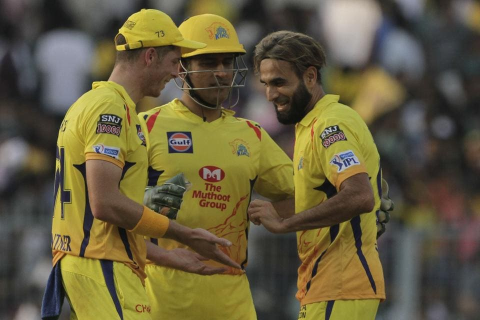 Chennai Super Kings' teammates congratulate Imran Tahir, right after taking wicket of Kolkata Knight Riders' Chris Lynn during the IPL cricket T20 match against in Kolkata. (AP)