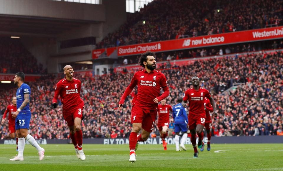 Liverpool's Mohamed Salah celebrates scoring their second goal against Chelsea on April 14. The English Premier League is in for a frenzied finish.