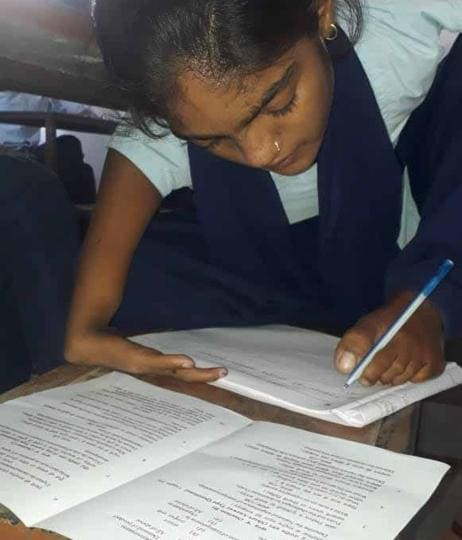 Mamata Patel,writes with feet,specially abled student