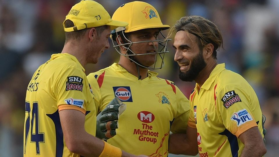 Imran Tahir of Chennai Super Kings celebrates the wicket of Chris Lynn with captain MS Dhoni.