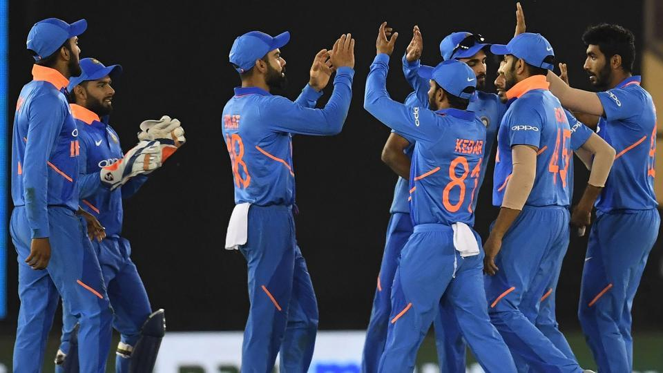 Indian cricket team players celebrate the wicket of Australia cricketer Usman Khawaja.