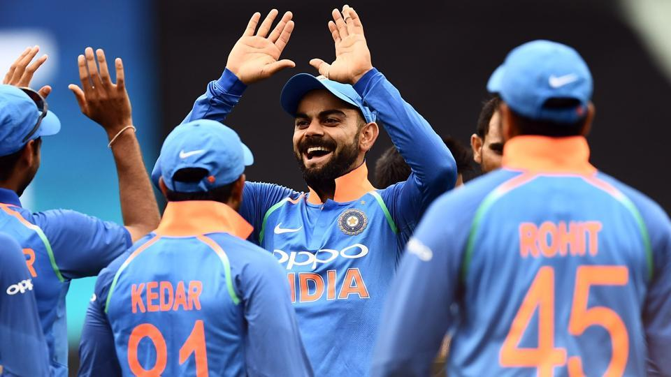 India's Virat Kohli (C) celebrates with teammates after the dismissal of Australia's Glenn Maxwell.