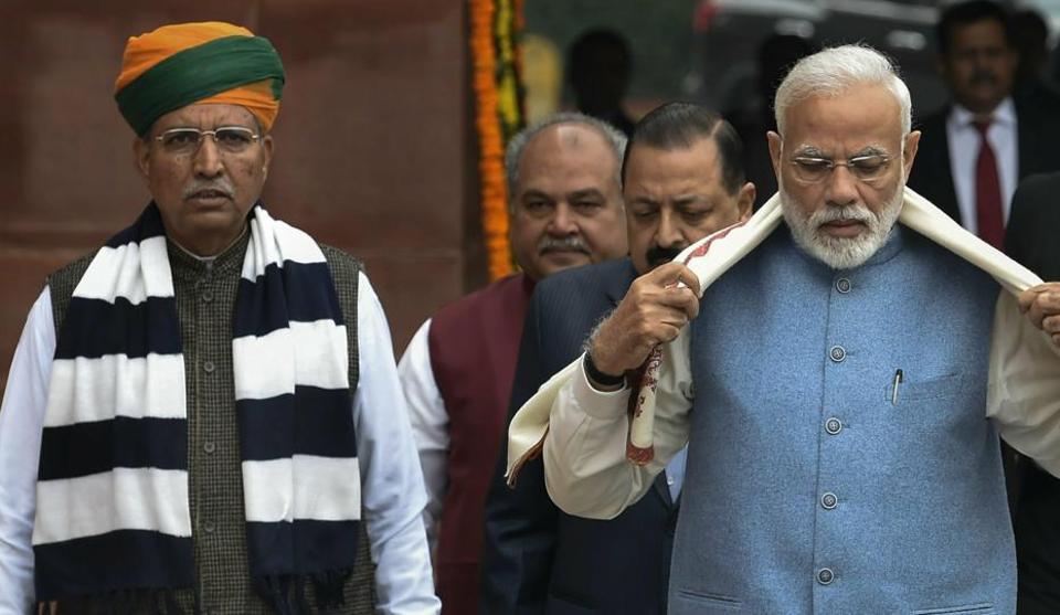 File photo of  Prime Minister Narendra Modi along with minister of state Arjun Ram Meghwal on the first day of Budget Session of Parliament, in New Delhi, Thursday, Jan 31, 2019.