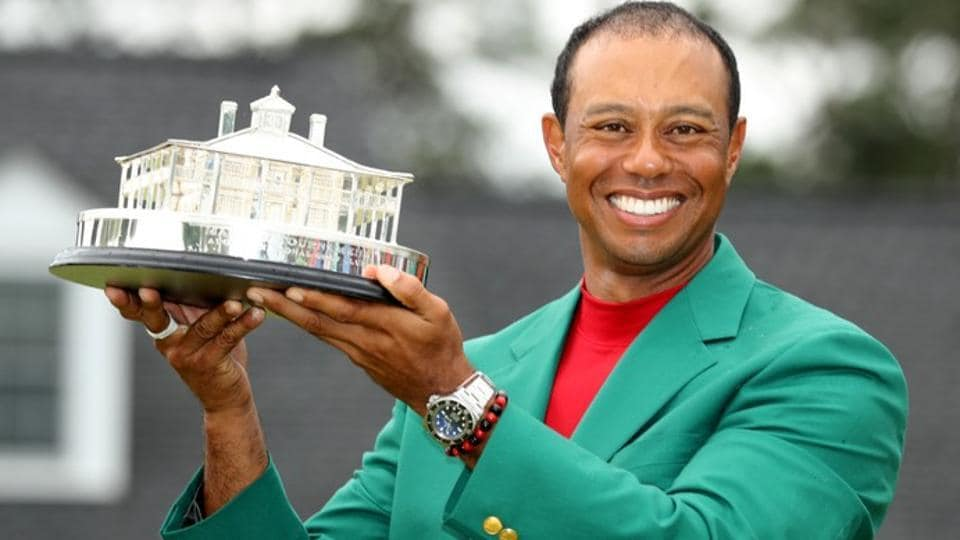 Tiger Woods of the U.S. celebrates with with his green jacket and trophy after winning the 2019 Masters.