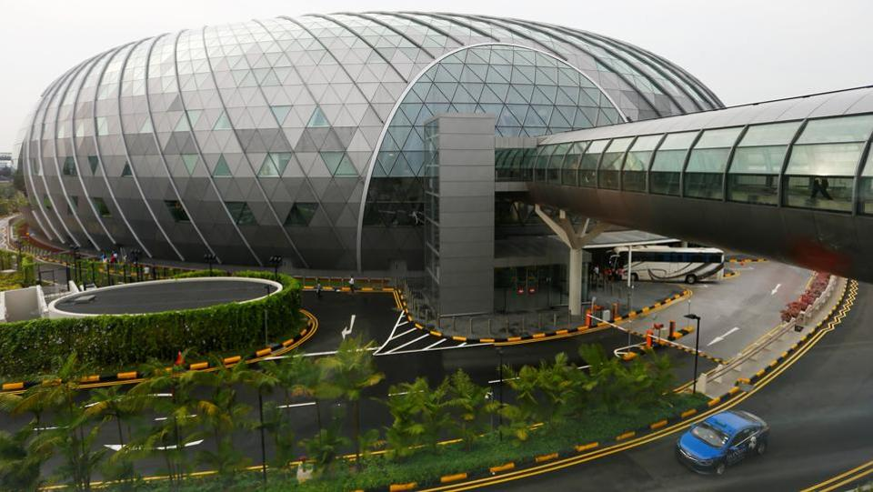 "A general view shows the facade of Jewel, along with a walkway linking it to terminals. Reportedly built at a cool Sg$1.7 billion ($1.25 billion), the ""Jewel"" centre has gardens growing over four storeys, as well as 280 retail and food outlets, a hotel and cinema. It links to three of the airport's terminals. (Feline Lim / REUTERS)"