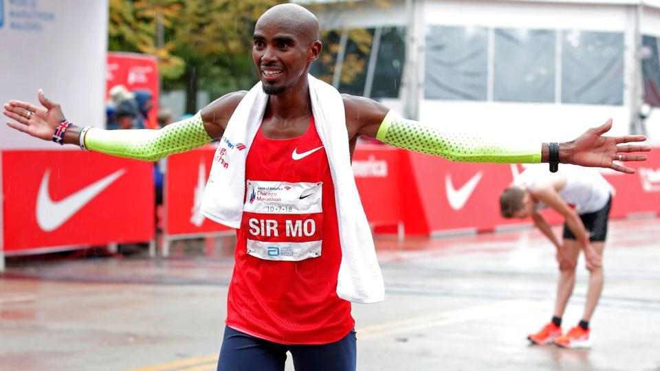 Mo Farah of Britain celebrates after winning the Chicago Marathon in Chicago, on October 7, 2018