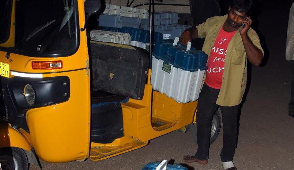 The dummy EVMs were being shifted from the local tehsildar's office to the strong room at the Indoor Stadium in Jagitial in an auto rickshaw.
