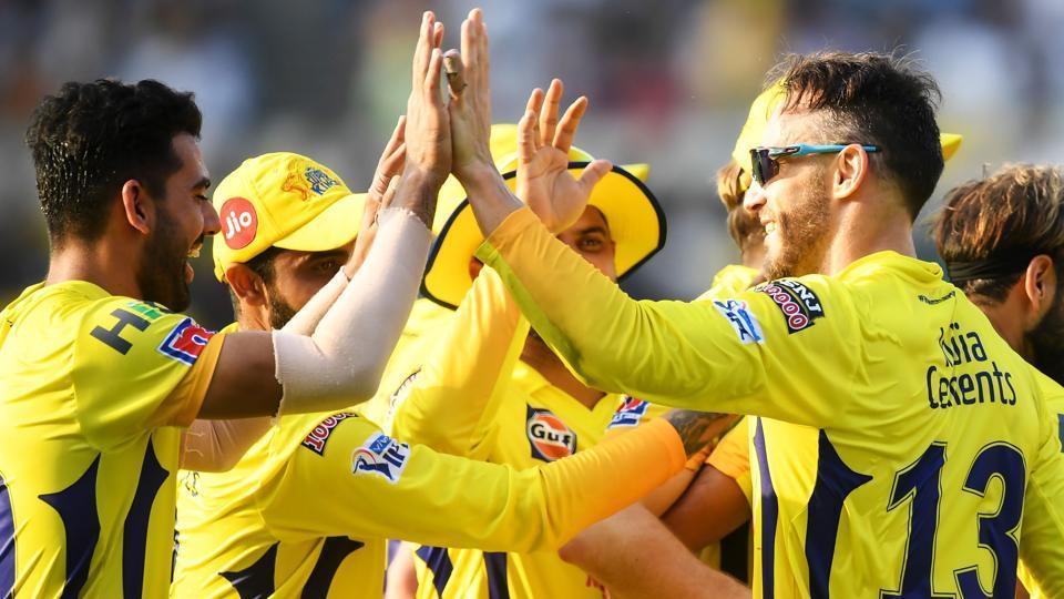 Chennai Super Kings cricketer Faf Du Plessis (R) celebrates with teammates.