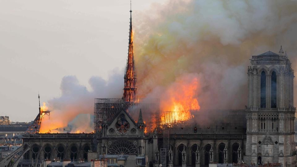 Smoke billows as flames burn through the roof of the Notre-Dame de Paris Cathedral on April 15, 2019, in the French capital Paris. Notre-Dame Cathedral went up in flames on Monday in a roaring blaze that devastated the Parisian landmark, one of France's most visited places. Flames burst through the roof of the centuries-old cathedral and quickly engulfed the spire, which collapsed. (Fabien Barrau / AFP)