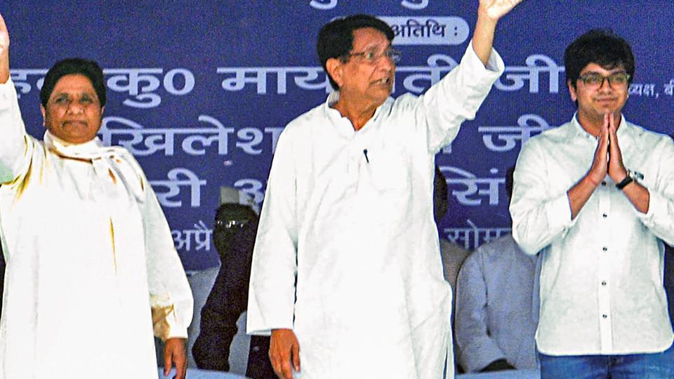 (Left to Right) Bahujan Samaj Party supremo Mayawati, Rashtriya Lok Dal chief Chaudhary Ajit Singh, and Mayawati's nephew Akash Anand standing during an election campaign for the ongoing Lok Sabha elections