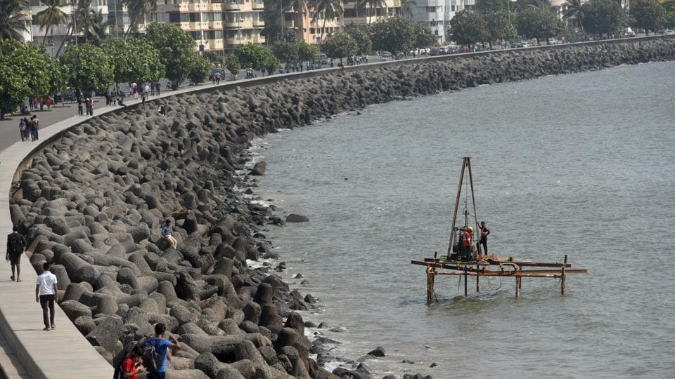 Workers doing soil testing for coastal road project at Marine Drive in Mumbai, India, on Friday, April 5, 2019.