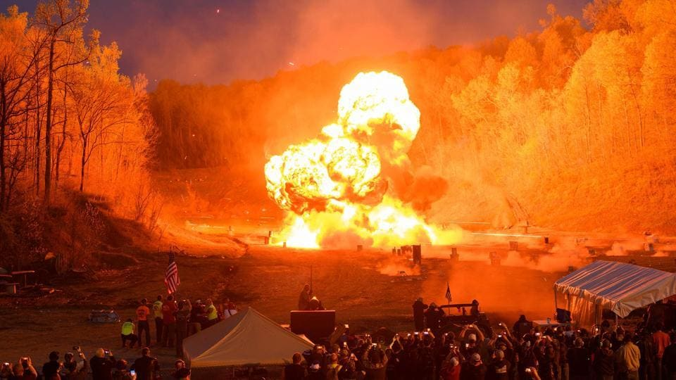"An explosion goes off at the start of the night shoot. Winters said gun enthusiasts from other countries come to Knob Creek ""just to play."" ""Because they don't have those abilities,"" he said. ""They don't have those rights."" The next machine gun shoot takes place in October. (Andrew Caballero-Reynolds / AFP)"