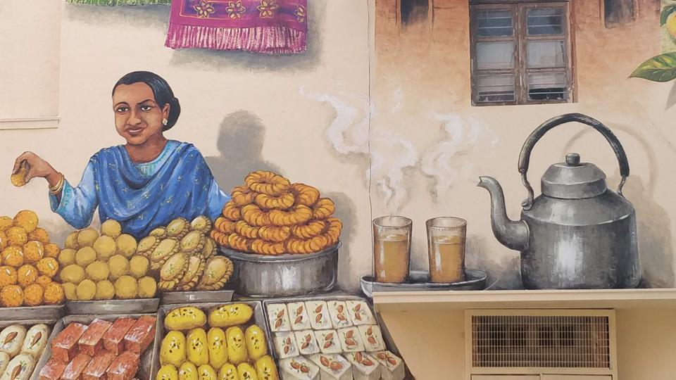 This wall in Lodhi Colony, New Delhi has been painted by Yip Yew Chong, one of Singapore's most popular mural artists.