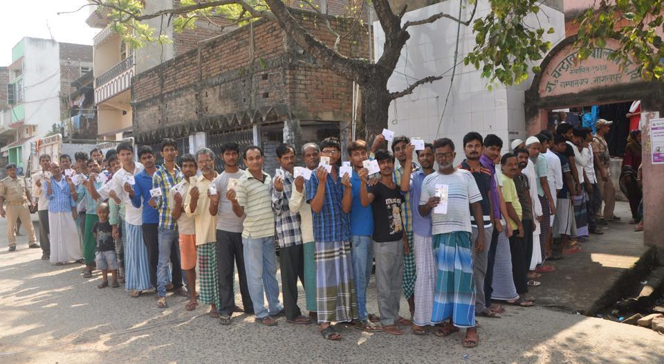 Bihar, India – Voters wait in a long queue to cast votes during the first phase of Bihar Assembly polls, outside a polling booth at Champanagar Tanti Bazar of Nathnagar, in Bihar, India on Monday, October 12, 2015. (HT Photo) *Elections*