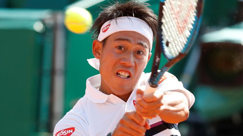 Japan's Kei Nishikori in action during his second round match against France's Pierre-Hugues Herbert.