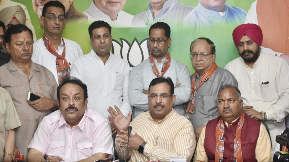 Haryana finance minister Captain Abhimanyu (Centre), BJP Punjab president Shwait Malik (left) and others addressing a press conference in Amritsar on Wednesday.