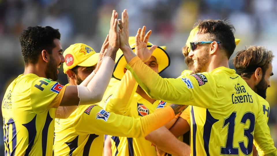 Chennai Super Kings cricketer Faf Du Plessis (R) celebrates with teammates after taking a catch.