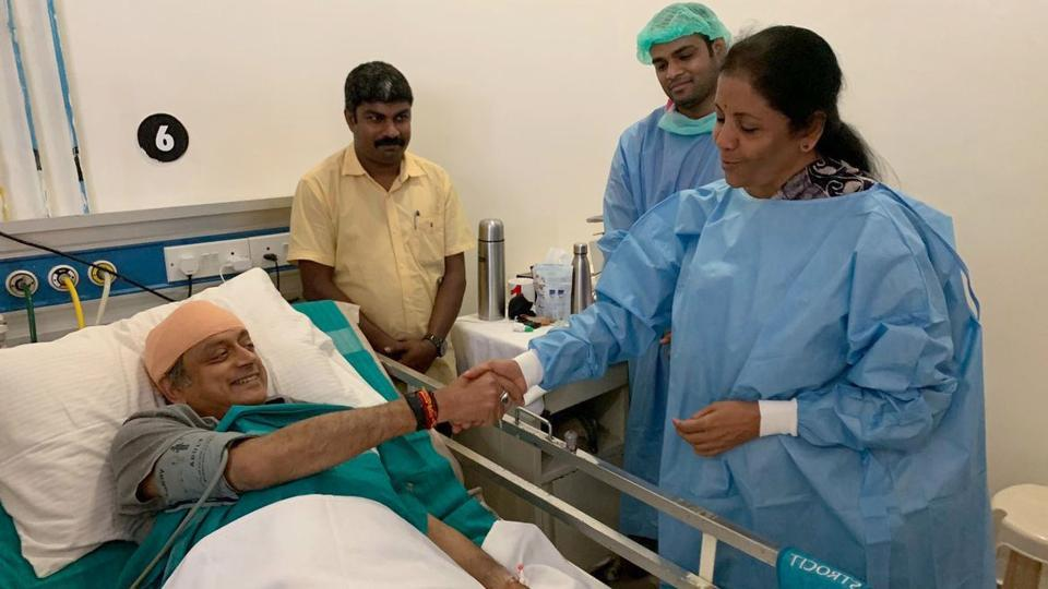 Kerala, April 16 (ANI): Defence Minister Nirmala Sitharaman meets Congress candidate for Thiruvananthapuram Shashi Tharoor at a hospital in Thiruvananthapuram on Tuesday. Shashi Tharoor injured during a religious ritual at a temple in Kerala. (ANI Photo)