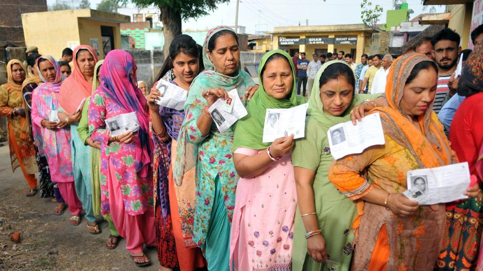 Jammu, India - April 11, 2019: Voters stand in queues to cast their votes at a polling booth for the first phase of general elections, in Jammu, India, on Thursday, April 11, 2019. Voters in 18 Indian states and two Union Territories began casting ballots on Thursday, the first day of a seven-phase election staggered over six weeks in the country of 1.3 billion people. (Photo by Nitin Kanotra / Hindustan Times)