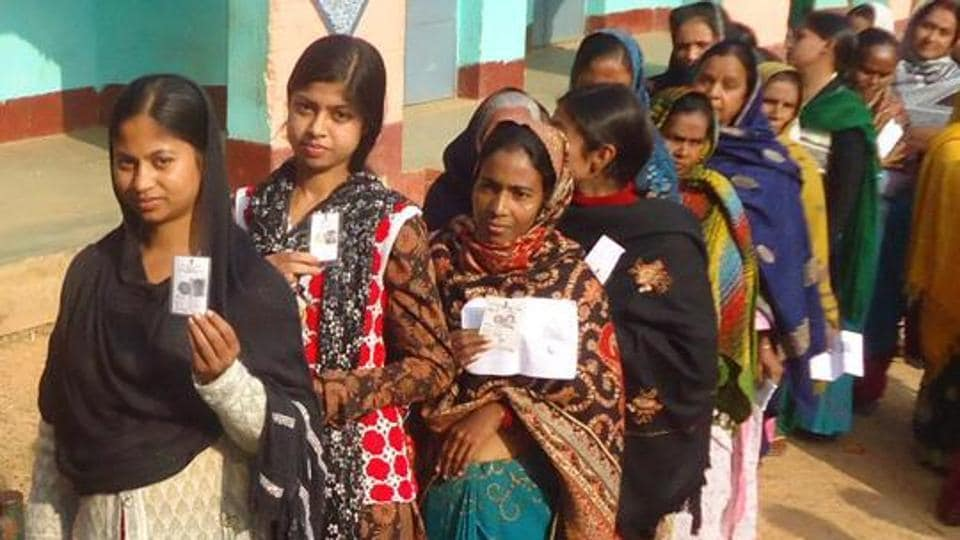 Dumka , Jharkhand, INDIA – December 20: Voters queue waiting to cast their votes on 5th phase election of Jharkhand assembly poll for Santhal Praganna at a polling booth in Dumka on Saturday December 20, 2014-(Photo--Hindustan Times)