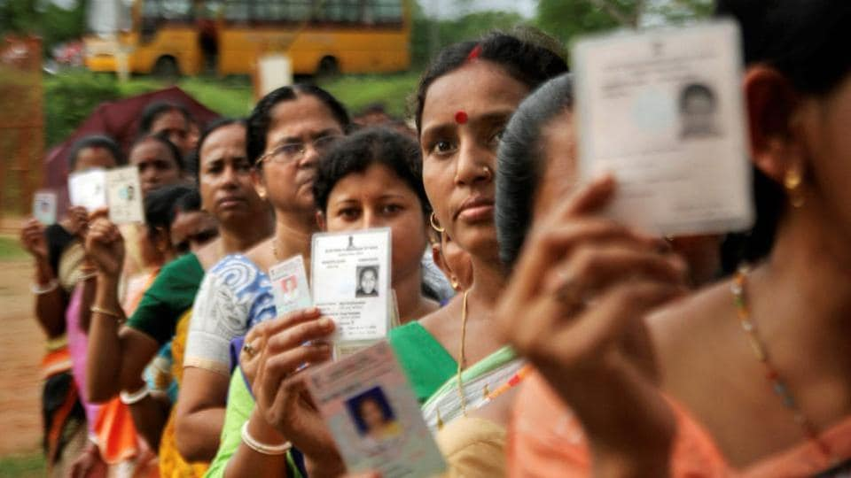Agartala: Women show their voter identity cards as they stand in a queue before casting their votes during the first phase of the general elections, at a polling station in Agartala, Tripura, Thursday, April 11, 2019. (PTI Photo)(PTI4_11_2019_000055B)