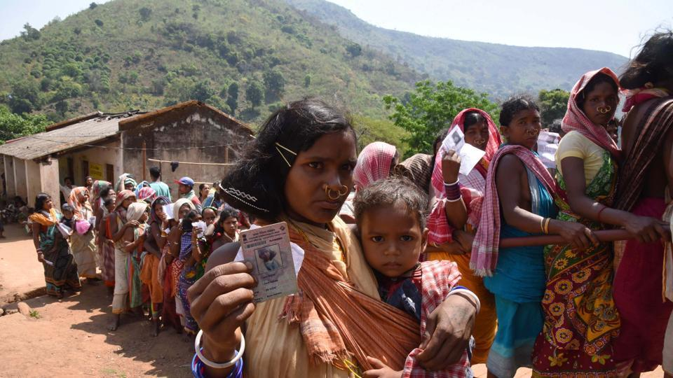 Odisha, India-April 11, 2019: Tribal women belonging to Dongria Kondh community stand in a queue to cast their vote during the first phase of the Lok Sabha elections, in Rayagada district, Odisha, India, on Thursday, April 11, 2019. (Photo by Arabinda Mahapatra / Hindustan Times)
