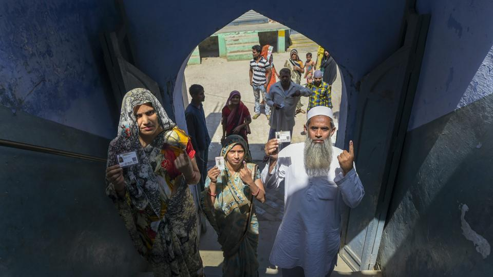 People show their ink-marked finger after casting vote at a polling station at Siyana, Bulandshahr. The voter turnout stood at 38.94% voter turnout at 1 pm in Uttar Pradesh. The highest was in Amroha- 43.26%, followed Hathras- 41.18, Bulandshahar- 39.70%, Nagina- 38.71%, Agra- 38.24%, Aligarh- 37.60%, Mathura- 36.90%, Fatehpur Sikri- 35.96%. (Vijay Verma / PTI)