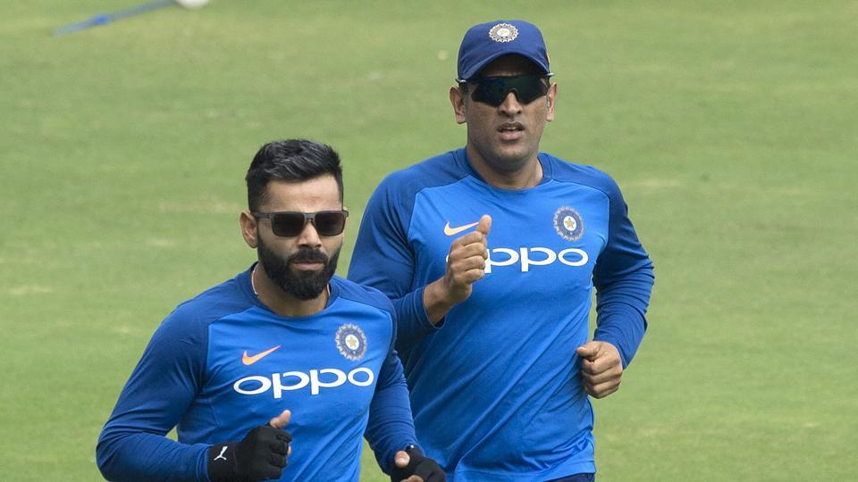 Indian captain Virat Kohli, left, with M S Dhoni, right warm up during a practice session ahead of the first one day international cricket match against Australia, in Hyderabad, India, Friday, March 1, 2019. (AP Photo/Mahesh Kumar A.)