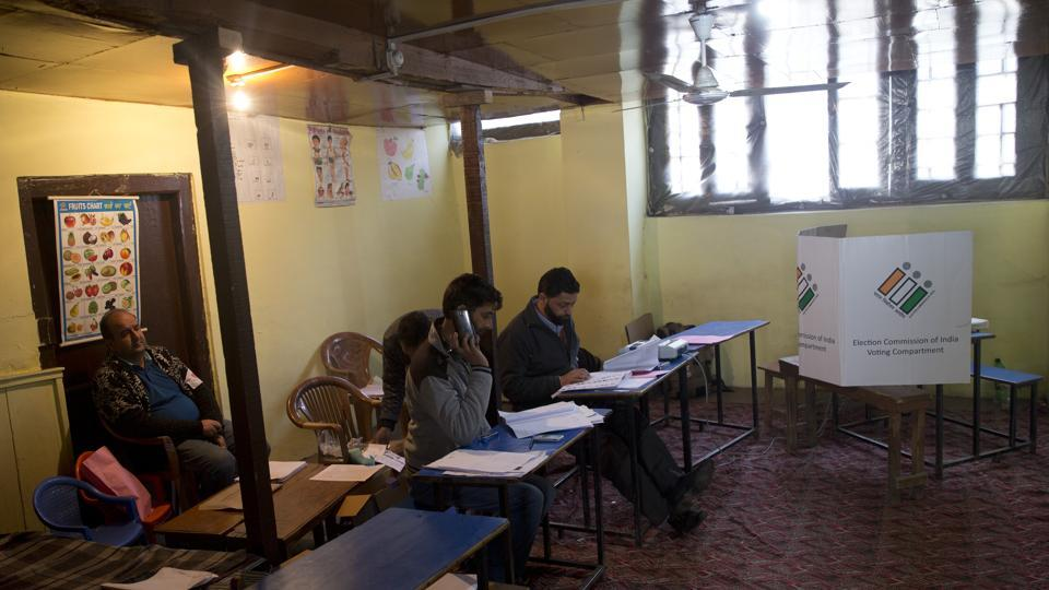 Election officers sit inside an empty polling station during in Srinagar. Kashmiri separatist leaders who challenge India's sovereignty over the disputed region have called for a boycott of the vote. People voted in large numbers in Jammu and Kashmir's Udhampur Lok Sabha seat but polling was muted in the Srinagar Lok Sabha constituency. (Dar Yasin / AP)