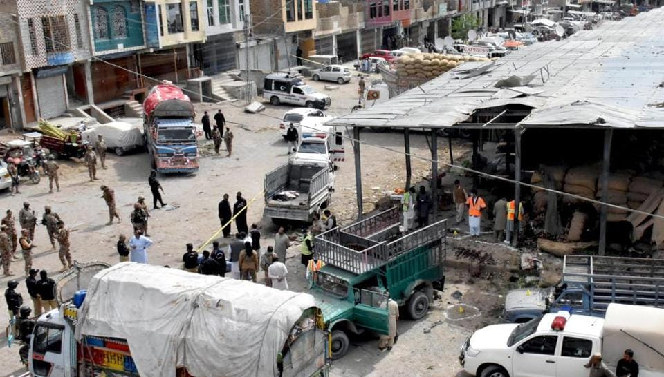 Rescue workers and army soldiers gather at the site of a blast at a vegetable market in Quetta, Pakistan on April 12, 2019.