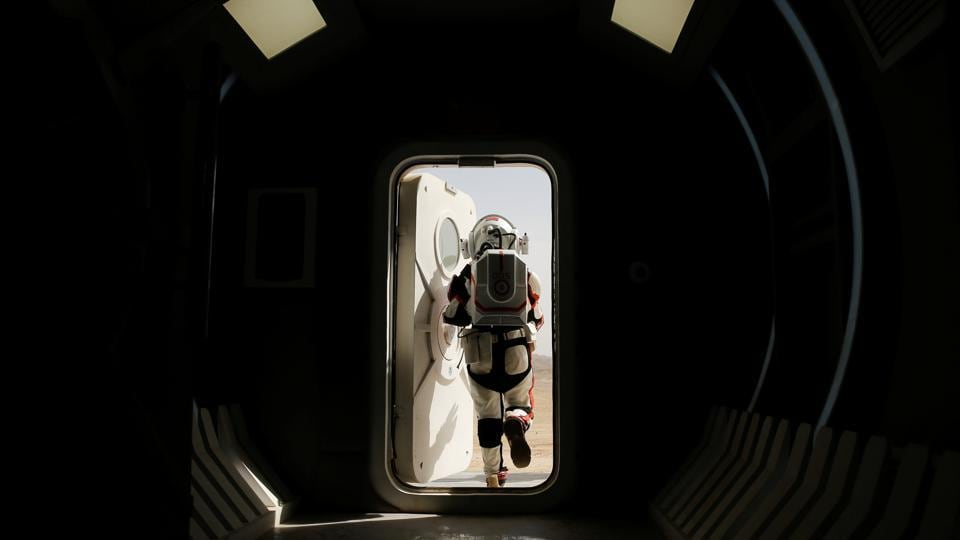 In the middle of China's Gobi desert sits a Mars base simulator, but instead of housing astronauts training to live on the Red Planet, the facility is full of teenagers on a school trip. Here seen is a staff member wearing a mock space suit stepping out of the Mars simulation base. (Thomas Peter / REUTERS)