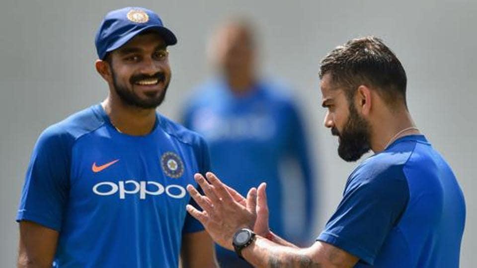 Skipper Virat Kohli talks to Vijay Shankar during a practice session ahead of the 2nd ODI cricket match against Australia, at Vidarbha Cricket Association Stadium in Nagpur, Monday, March 4, 2019.