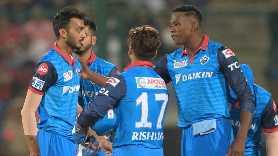 Delhi Capitals team players celebrates with teammates the dismissal of Mumbai Indians cricketer Ben Cutting.