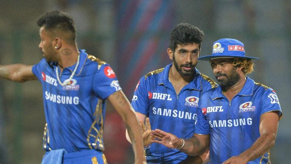 Mumbai Indians cricketers walks back after winning the match against Delhi Capitals.