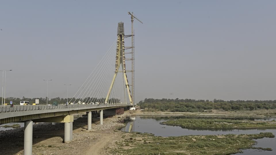 Even five months after construction, debris, which has not been removed, is choking the flow of the river Yamuna.