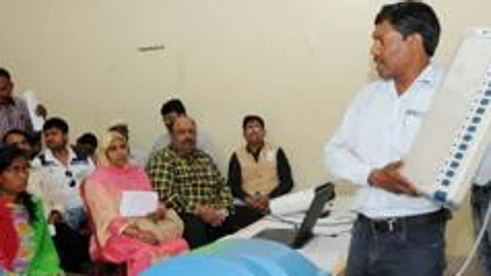 Polling officers attend a training programme on how to use EVM with Voter Verifiable Paper Audit Trail (VVPAT) machine.