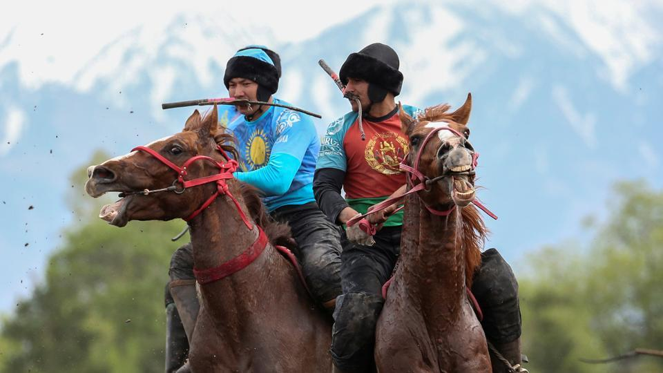 Horsemen play Kokpar, a traditional game between two teams competing to throw a dummy of a goat into a scoring circle, during the first Asian Equestrian Championship near Almaty, Kazakhstan. (Pavel Mikheyev / REUTERS)