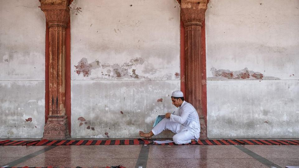 A student takes exams at Fatehpuri Masjid, in the old quarters of New Delhi, India. (Noemi Cassanelli / AFP)