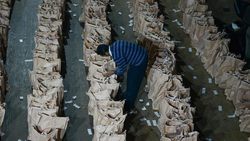 A polling official arranges materials which will be used for elections at a voting distribution point in Darjeeling, West Bengal. (Diptendu Dutta / AFP)